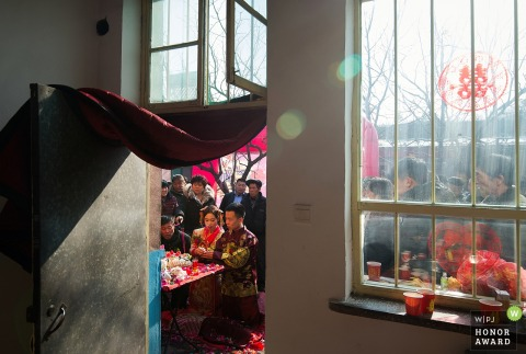 Guests watching the bride and groom during China wedding ceremony