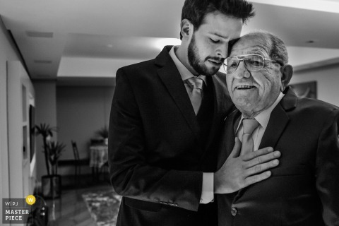 Rio Grande do Sul Wedding Photojournalist | a tender moment with the groom and his grandfather in a black-and-white image