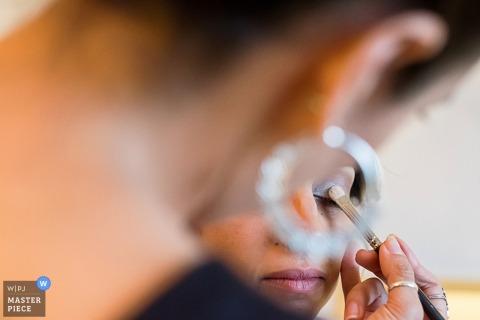 Image of a Detroit bride having eye makeup applied