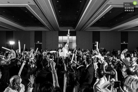 The groom is lifted high above the guests on the dance floor at the MGM Grand Hotel and Casino, Detroit, MI