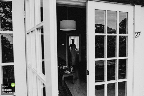 Australia Bride silhouetted in the doorway