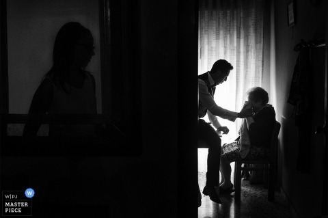 Valencia Wedding Photojournalist | Black and white silhouette image of wedding day preparations at the hotel