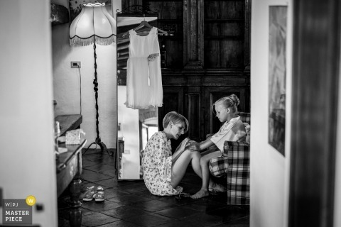 Fattoria la Loggia, Florence, Tuscany Wedding Photo of flower girl getting nails done