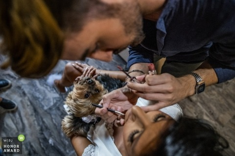Dog watches carefully as bride gets makeup in Calabria