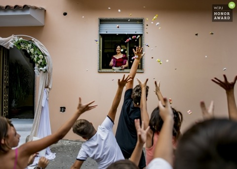 Kids throw candy before the ceremony in Italy