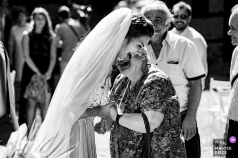 Lovech Wedding Photo of the bride greeting an elderly guest outdoors