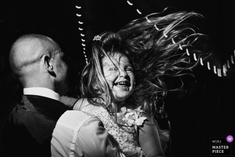 Somerset, VA Wedding Photo of a young girl dancing at the reception with her hair flying