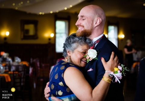 Denver Colorado groom dances with his mother at the wedding reception