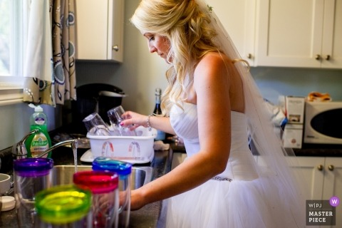 Oak Island Resort, Nova Scotia, Canada wedding photo of bride doing dishes