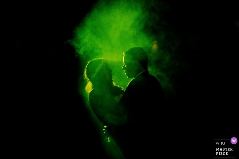 Green fog and lights on the dance floor for this bride and groom at their Santo Tirso, Portugal wedding reception party