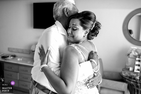 The bride hugs her father after getting ready for her wedding in Playa del carmen Mexico