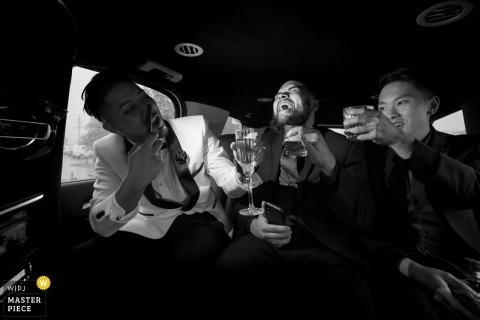 Groomsmen taking a limo ride to wedding reception | Greenville, South Carolina
