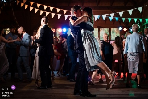 Poland Wedding Photojournalist | dance floor kiss for a couple during the reception