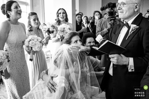 Bridesmaids laughing during the ceremony - Boston, MA Black and white wedding photograph
