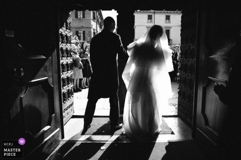 Portofino Wedding Photojournalist | silhouette image of the bride and groom standing in a doorway looking out