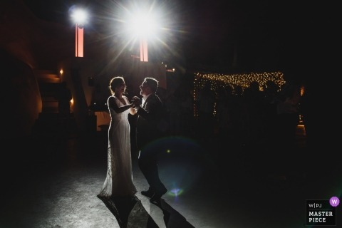 A wedding couple perform their first dance at Venetsanos Winery Santorini