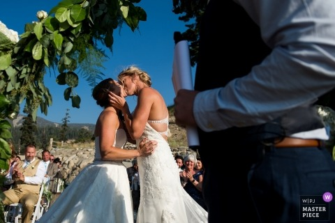 Lake Tahoe, CA Wedding Photojournalist | the outdoor wedding ceremony ends with a kiss