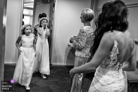 Flower girl seeing the bride in her dress for the first time at this South Lake Tahoe, California wedding