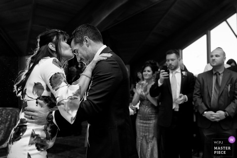 South Lake Tahoe, California indoor wedding ceremony kiss