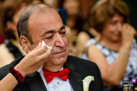Dad wiping tears during ceremony at Tavern on the Green