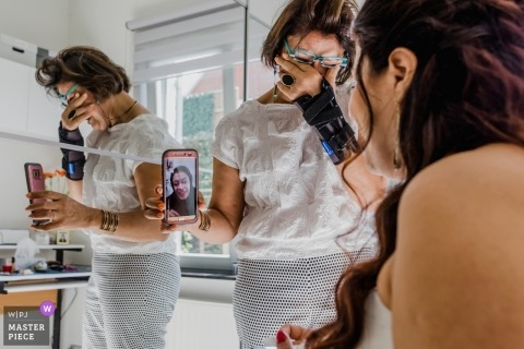 Lasne Wedding Photojournalist | emotional face time moment while the bride is getting ready
