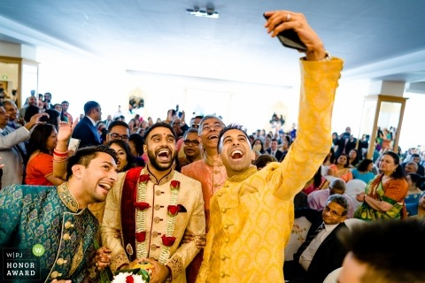 A group selfie with the groom at a London England wedding