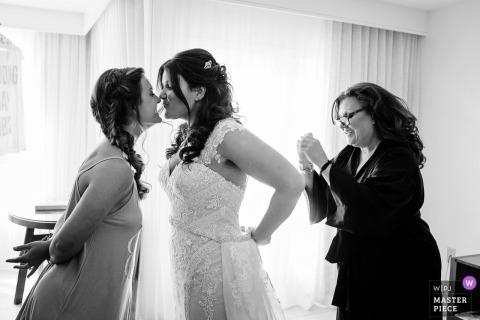 Key West Wedding Photojournalist | Florida bride putting on her dress on wedding day