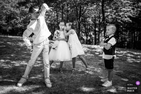 Cotes-d'Armor Wedding Photojournalist | Black and white photo of flower girls and children wedding guests playing outside at the reception