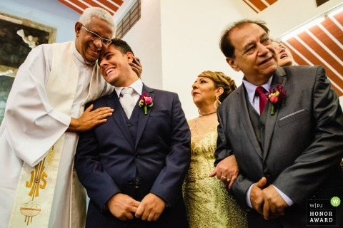 Ouro Preto Priest embraces the groom as his bride makes her way