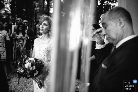 Portofino Wedding Photojournalist | the bride waits during the ceremony in this black-and-white photo