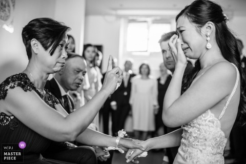 Paris Wedding Photojournalist | the bride and her mother share an emotional moment together at the wedding