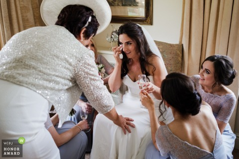 Wicklow, Ireland bride gets emotional around her bridesmaids before the wedding