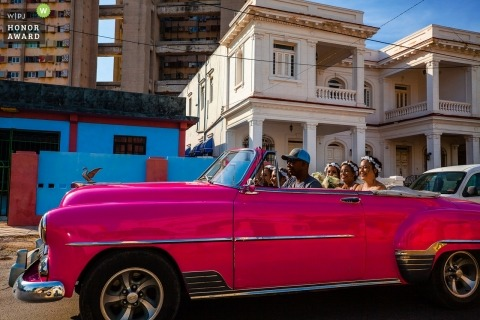 Havana Bridesmaids enjoying convertible car ride to the wedding ceremony in Cuba