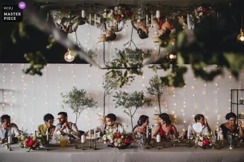 Porto Wedding Photojournalist | the wedding reception head table at this Portugal celebration