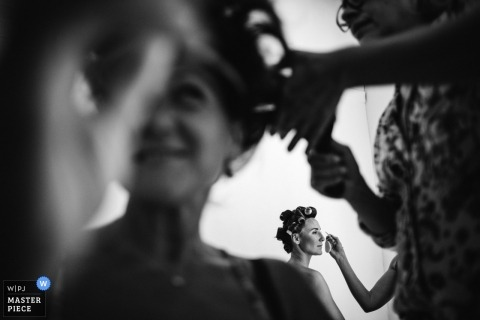 Porto Wedding Photojournalist | curlers and makeup as the women prepare for the wedding ceremony