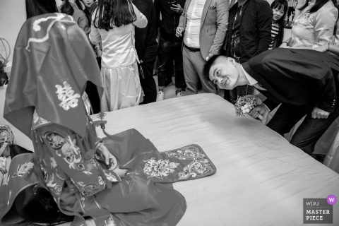 Shaanxi Wedding Photojournalist | sneaking a peek under the brides Head covering in China