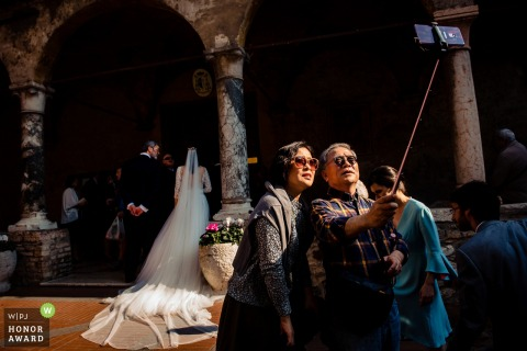 Guests or possibly spectators, trying to get a good selfie during the Hungary ceremony