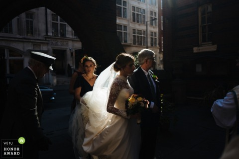 London, England Beautiful afternoon lighting as the bride Head to the church with her father