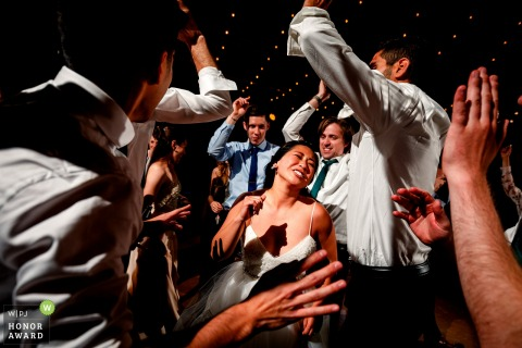 Bride and groom celebrating with guests on the dance floor at the reception in Lyons, CO