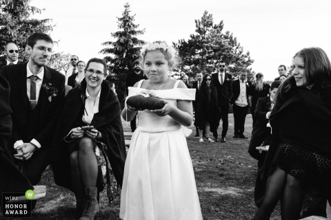Guests watch as the little girl anxiously walks down the aisle - la Grange 77