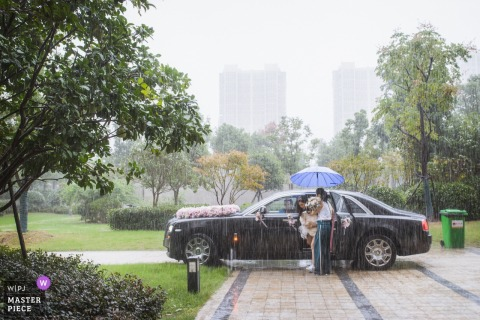 China Wedding Photojournalist | Down pouring rain on wedding day