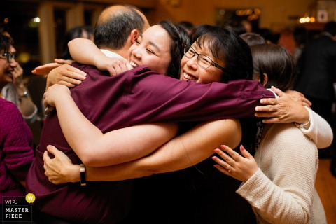 A group Family hug at a Rhode Island reception party