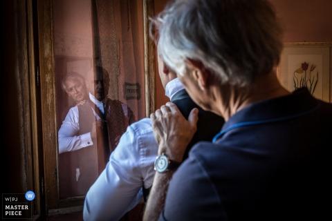 father and son getting ready for wedding | castello di titignano italy