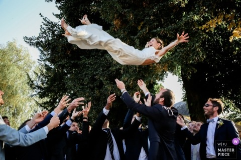 Paris Wedding Photojournalist | France bride tossed in the air