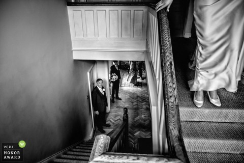 Great Tythe Barn in Tetbury - Wedding Photograph of Bride about to come down the stairs - Father of the Bride
