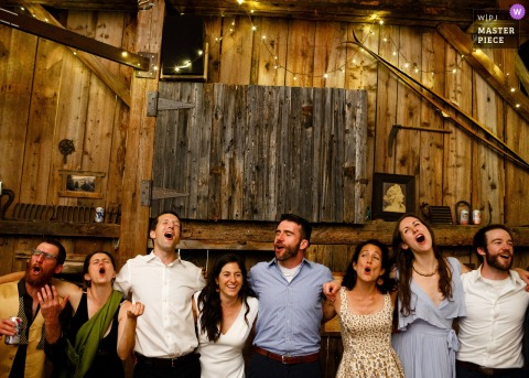 Toronto Wedding Photojournalist | the wedding party is singing at the reception in Ontario