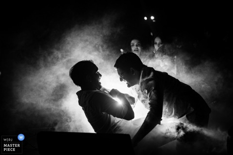 Cyprus Wedding Photojournalist | smoke and fog in this black and white wedding reception photo