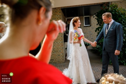 Barchem bridesmaid getting emotional as she sees the bride in her full dress on wedding day