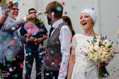 București Wedding Photojournalist | bride and grown exit to a confetti shower in Romania