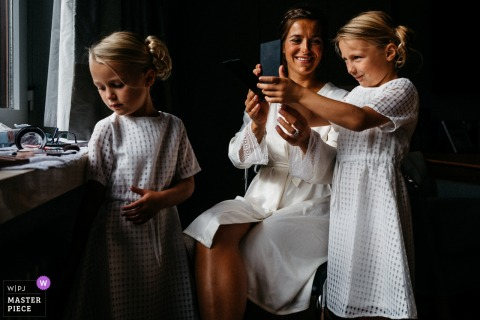 Waasmunster Wedding Photojournalist | Netherlands bride has some special time with two young flower girls